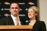 0658 Denver Broncos Josh McDaniels stands with his wife after he is introduced as the new head...