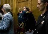 Andrea Glass gives Dr Andrea Larabee a Denver pediatrician a hug after a press conference about...