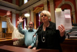 (0334) State Representative Buffie McFadyen holds up a stack of petitions as convenience store...
