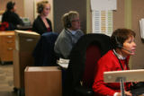 (0211 Michelle Wright, right, takes a phone call from a person seeking answers about unemployment...