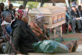 (NYT22) GA-MODJADJI, South Africa -- June 20, 2005 -- SAFRICA-RAIN-QUEEN -- Relatives sit near the...