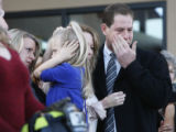 Brian Kopp's family members weep as his casket is carried by at the Church of the Rock in Castle...