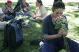 Kimberly Atencio (cq) gets teary after Diane Cox gives her flowers and a breakfast meal from...