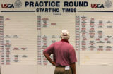 Course Evacuation volunteer Dale Hart (cq) reads the practice schedule at the 2005 U.S. Women's...