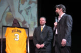Colorado Rockies first baseman Todd Helton, right, has his University of Tennessee No. 3 jersey...