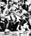 Denver Nuggets guard Fet Lever, right, of the West team blocks the path of the East's Michael...