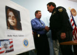 Clear Creek County Sheriff Don Krueger, right, shakes hands with a fellow members of law...