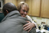 Cherie Yager, who volunteers as an optician 2-3 days a week at the Stout Street Eye Clinic, gets a...