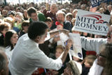 Republican presidential candidate Governor Mitt Romney shakes the hands of supporters at Freeway...