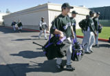 3418 Colorado Rockies' newbee RHP Casey Weathers carries a few of his teammates bags to pay his...