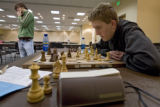 DM1859   Josh Divine, 17, left, of Colorado Springs steps away from the table as he plays Tyler...