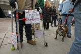 Gerald Lopez (cq) from Lakewood walks along with Maddie, an english bulldog and other concerned...