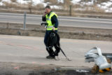 Police remove a child's car seat from the scene of a crash on C-470 near Santa Fe Sunday February...