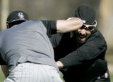 3768 Colorado Rockies' Ryan Spilborghs, right, gets elbowd by friend and teammate Troy Tulowitzki,...