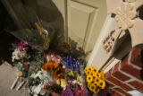 MJM193  A makeshift memorial sits outside the Autumn Creek condominium of Marco and Vera Escobedo...