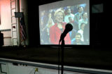 373 Sen. Hillary Clinton is projected on a large screen as she hosts Voices Across America: A...