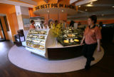 There are still pies as Ana Lopez walks passed the front counter at the new Village Inn in...
