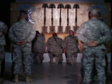 Soldiers pay their respects during a memorial service for five fallen soldiers at Camp Merez in...