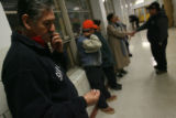 carlos carranza (cq) stands in line along other Democrats inside Gilpin Middle School in Denver on...
