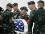 ALAN LEON | ROCKFORD REGISTER STAR Army pallbearers carry the body of Spc. Kevin Shields to his...