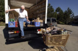 Jefferson Award winner Bill Hammond (cq Bill Hammond) 80, climbs out of a truck containing donated...