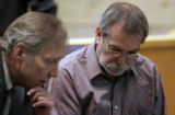 Ricky Lee Harnish, 52, right, makes an initial appearance  in  Clear Creek County Courthouse in...