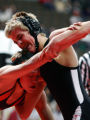 Kyle Monson, 15, of Lamar left, tries to get out of a hold by Presley Pappachek, of Roosevelt,...