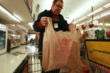 DM0001   Patrick Polly, 66, bags groceries at the King Sooper's at 9th Avenue and Downing Street...