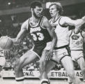 Kareem Abdul-Jabbar of Los Angeles, shown being guarded by Denver's Dan Issel, Wednesday saught...