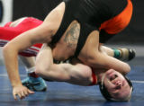 Caleb Wyatt, of Hotchkiss, strains to pin Tommy Ketchum, of La Junta, at the 3A boys 2008 State...