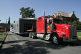 Christa and Brad Tomecek's (cq) pre-fabricated house, sits on a truck in two pieces before they...
