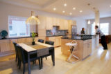 Christa and Brad Tomecek talk around the kitchen island in their new prefab house on February 4,...