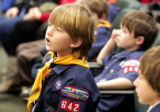 Tom Biasi, a Cub Scout with Pack 642 from Evergreen strains to see, as legislators vote on HB 1151...