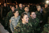 DM0152   Senior airman Ashlee Dickens, bottom center, and about 200 other Air Force personnel try...