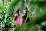 Larisa Lawrence (cq) tends to medicinal marijuana plants  Monday afternoon in her Denver home June...