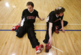 Andy Friednash, 17, left, and Ben Fishman, 16, of The Herzl/RMHA Tigers basketball team stretch...