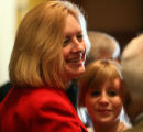 Rep. Elect Karen Middleton, D-Aurora,  greets friends after being   sworn in  by Speaker Andrew...