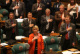 Republican members of the Colorado  House of Represntatives with their hands on hearts during...