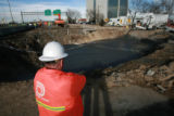 DM0172   Crews with Denver Water, CDOT and Qwest spent all day Sunday working on...
