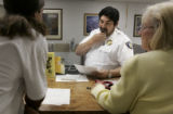 Kevin Beltramelli (cq) from Denver( left) is told by Animal Control Manager Major Juan Zalasar...
