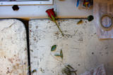 A rose lies on the cutting board of the The Brown Palace Flower Shop storage room as demand for...