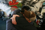 "DM0357   David ""Doc"" Anderson, right, gets a hug from Kyle Anderson at the Ink for the..."