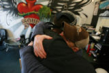 "DM0358   David ""Doc"" Anderson, right, gets a hug from Kyle Anderson at the Ink for the..."