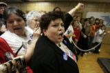 Local activist Dr. Nancy Vera (cq) cheers for Hillary Clinton inside the Clinton campaign...
