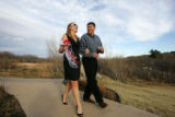 Annie Hellums (cq), walks with her father, Ed Hellums (cq) during her wedding rehearsal at...