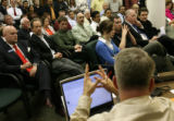 MJM471 A packed committee room listens to Rep. David Balmer discuss Senate Bill 82, that would...