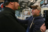 "DM0363   David ""Doc"" Anderson, right, gets a hug from Kyle Anderson at the Ink for the..."