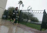 101 Colorado Rockies Clint Barmes runs through the rain to the batting cages at rain hampers the...