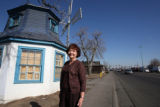 Nadine Caldwell (cq) stands in front of the old Dutch windmill on East Colfax Avenue near Peoria...