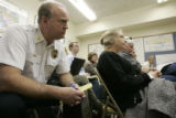 Bob Harvey, Chief of the Leadville Lake County Fire Dept. (left) takes part in a conference call...